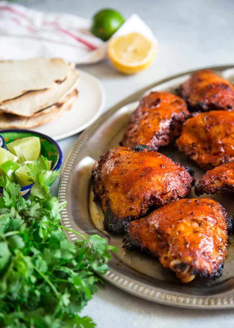My take on How To Make Pollo Asado starts with marinating chicken in orange and lime juice, oregano, cumin, garlic and achiote paste overnight. Grill & eat! keviniscooking.com