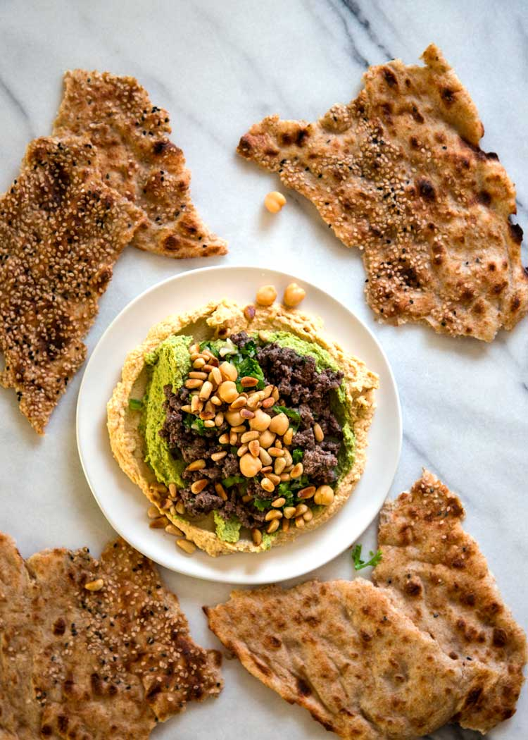 This Hummus with Lamb comes served with hummus flavored 2 ways, is topped with warm, spiced ground lamb and is topped with an incredible lemon pepper sauce. keviniscooking.com