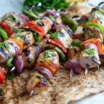 These Pork Kebabs have cubed, marinated center cut pork chop meat, cut vegetables and are grilled then topped with a lemon, honey and mint sauce drizzle. Easy AND amazing! keviniscooking.com