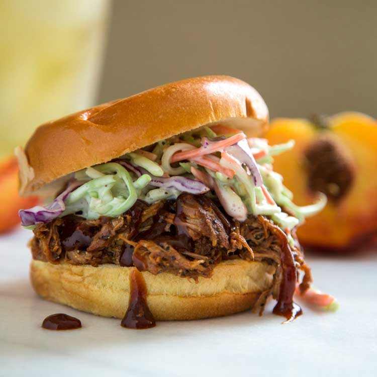 root beer pulled pork on bun with southern coleslaw