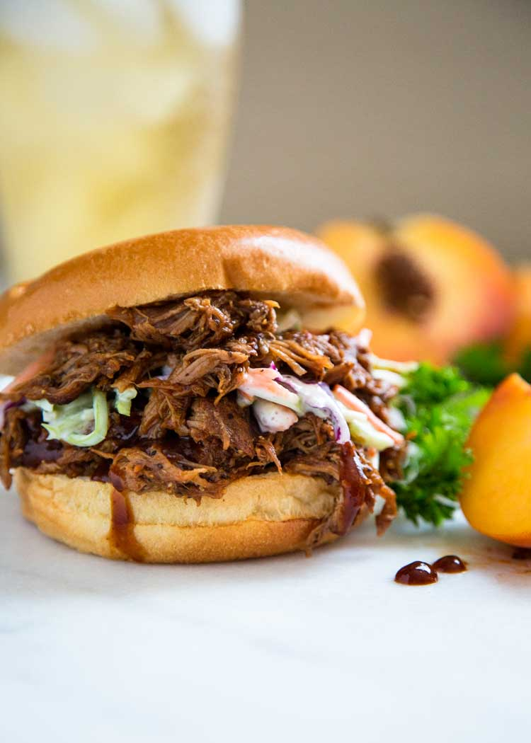This Root Beer Glazed Slow Cooker Pulled Pork is juicy, tender and sticky sweet with a bite, and gets a dose of reduced root beer for an extra flavor punch! keviniscooking.com