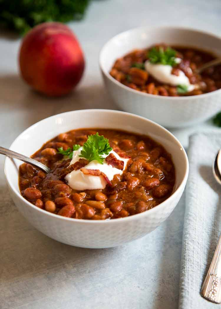 """These Sweet and Spicy Baked Beans have a secret flavor weapon that may sound strange, yet is so good. Peaches and bacon pack the flavor in these """"baked"""" beans. keviniscooking.com"""