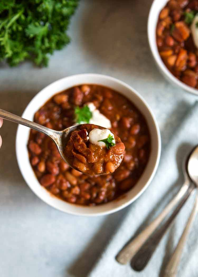 "These Sweet and Spicy Baked Beans have a secret flavor weapon that may sound strange, yet is so good. Peaches and bacon pack the flavor in these ""baked"" beans. keviniscooking.com"