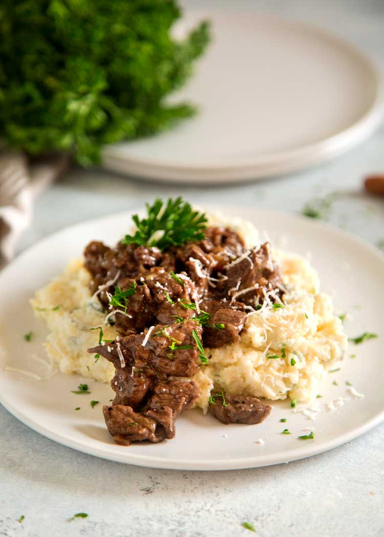 Tender Beef Tips in Red Wine Sauce is a wonderful French inspired comfort food meal. Sirloin beef tips are pan seared and browned while a quick pan sauce is made with butter, shallots, wine and herbs. keviniscooking.com