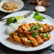 Grilled Thai Red Curry Chicken packs a flavor punch with homemade or store bought red curry paste and I step you through making it from marinade, grill to dinner! keviniscooking.com