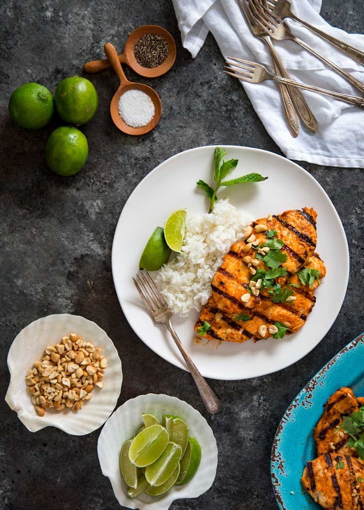 Grilled Thai Red Curry Chicken packs a flavor punch with homemade or store bought red curry paste and I step you through making it from marinade, grill to dinner. keviniscooking