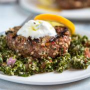 Mediterranean spiced ground lamb patty topped with tzatziki sauce
