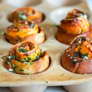 My baked Roast Beef Cheddar Muffins start with pizza dough smothered in dijon horseradish cream, layered with slices of tender roast beef and cheddar cheese. Perfect snack food! keviniscooking.com