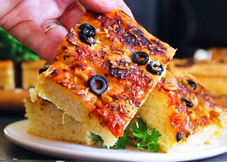 I show you step by step how easy it is to make my Zesty Homemade Focaccia Bread. Thick, airy, flat Italian bread that's your new garlic bread or roll substitute. www.keviniscooking.com