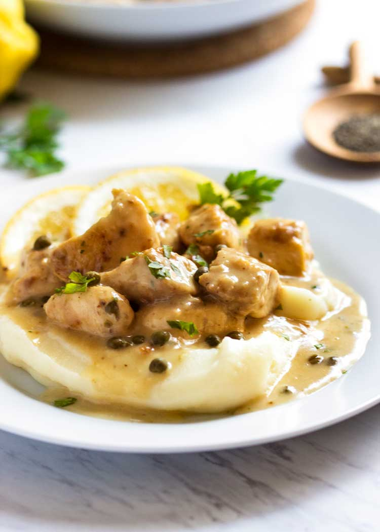No pounding out thin chicken pieces. This Chopped Chicken Piccata is served in a rich, lemony caper sauce over mashed potatoes. Easy, tasty comfort food! keviniscooking.com