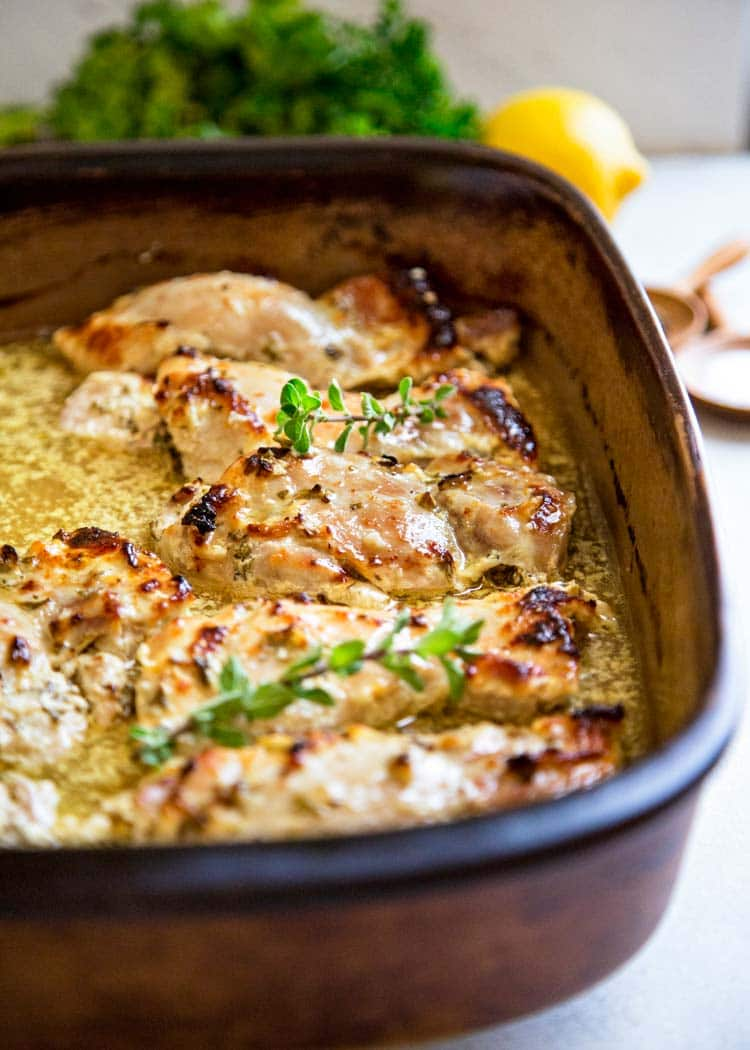 This amazingly delicious Easy Baked Greek Chicken starts with a marinade of lemon, garlic, oregano, olive oil, pepper flakes and thick Greek yogurt. So good! keviniscooking.com
