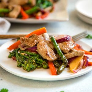 Tender pork sirloin, marinated in roasted garlic and herbs gets sliced and stir fried then tops vegetables coated in a wonderful maple cider glaze. Quick and easy dinner in minutes! keviniscooking.com