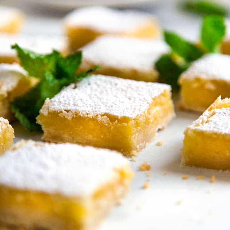 These Shortbread Lemon Bars are tart, sweet and the shortbread crust is crumbly soft. The perfect summer picnic dessert that can be enjoyed year round! keviniscooking.com