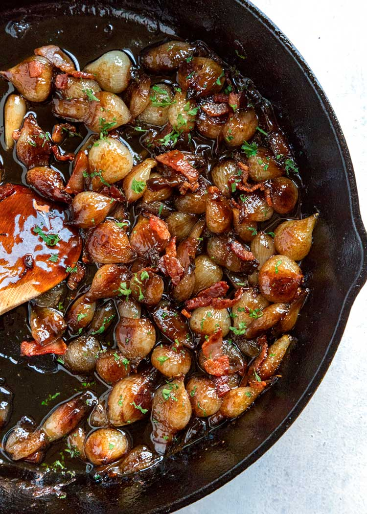 These Balsamic Glazed Pearl Onions with Bacon are perfect for any dinner table as a side dish or spooned over roasted or grilled meat. The caramelization! keviniscooking.com