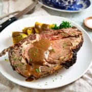 This Rib Roast starts with a brown sugar, coffee and bourbon rub. Blending the roasted shallots in the coffee cream gravy is just outstanding. keviniscooking.com