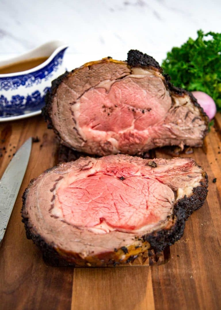 This Coffee Rubbed Rib Roast starts with a brown sugar, coffee and bourbon rub. Blending the roasted shallots in the coffee cream gravy is just outstanding! keviniscooking.com