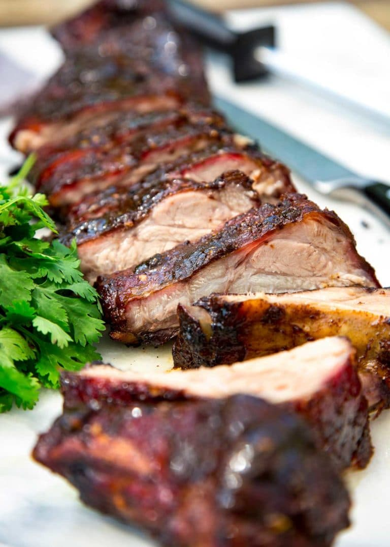 These Jamaican Jerk Pork Ribs are rubbed with a mouthwatering sweet and spicy paste made of three main ingredients: chile peppers, allspice, and thyme. Mind you not for the faint of heart! keviniscooking.com