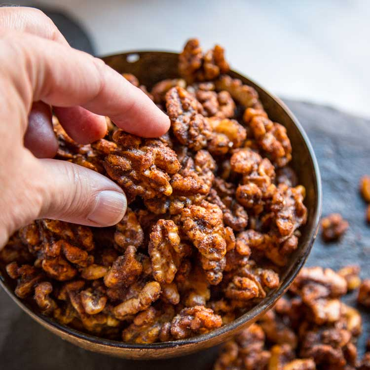 These addictive Smokey Spiced Walnuts get toasted in the oven after getting coated in a warm blend of curry powder, soy sauce, melted butter and Tabasco. keviniscooking.com