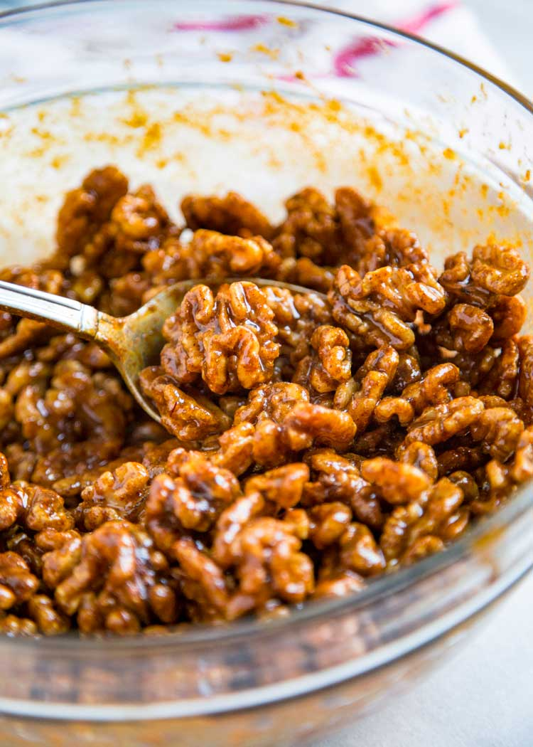 These addictive Smoky Spiced Walnuts get toasted in the oven after getting coated in a warm blend of curry powder, soy sauce, melted butter and Tabasco. keviniscooking.com