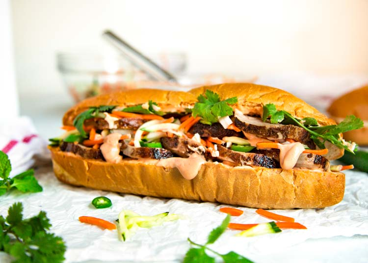 Teriyaki Pork Bahn Mi Sandwich has sliced, glazed pork tenderloin layered with pickled vegetables and herbs for a perfect lunch, party or Game Day favorite. keviniscooking.com