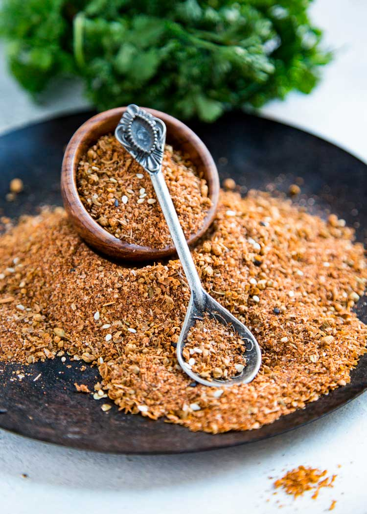 This Turkish Spice Blend is a warm and earthy seasoning rich with cumin, pepper, paprika and Middle Eastern spices and sesame seeds. Perfect on roasted meats, as a dry rub and seasoning. keviniscooking.com