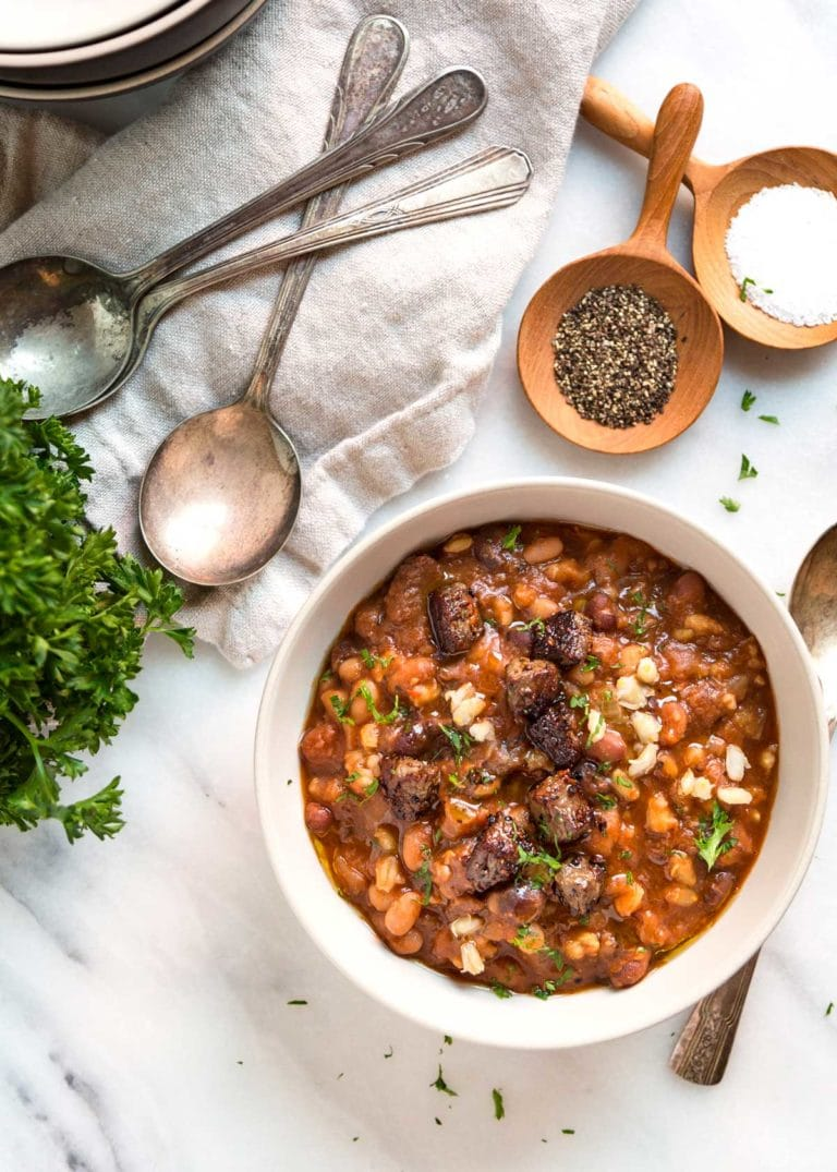 This Beef and Barley Soup has Montreal seasoned beef seared and caramelized before added to a Dutch oven or Instant pot with mixed beans and barley. So good! keviniscooking.com