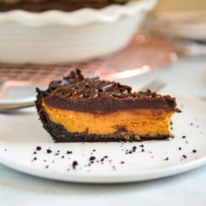 A piece of pumpkin pie with chocolate ganache