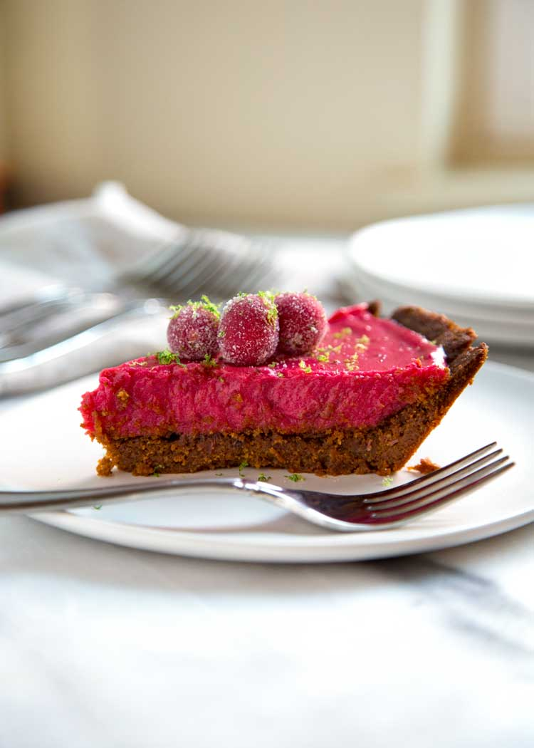 This Cranberry Lime Pie has a gingersnap cookie and walnut crust, a cranberry lime curd that is out of this world and topped with candied cranberries. Wow! keviniscooking.com