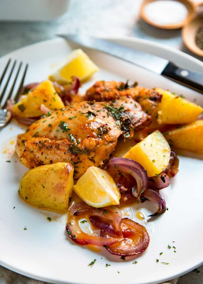 This Spanish Roasted Chicken and Potatoes is a one pan, super easy mid-week dinner for the family. Chicken thighs are seasoned with smoked paprika and lemon juice, slow roasted with red onions, garlic and potatoes and sherry.