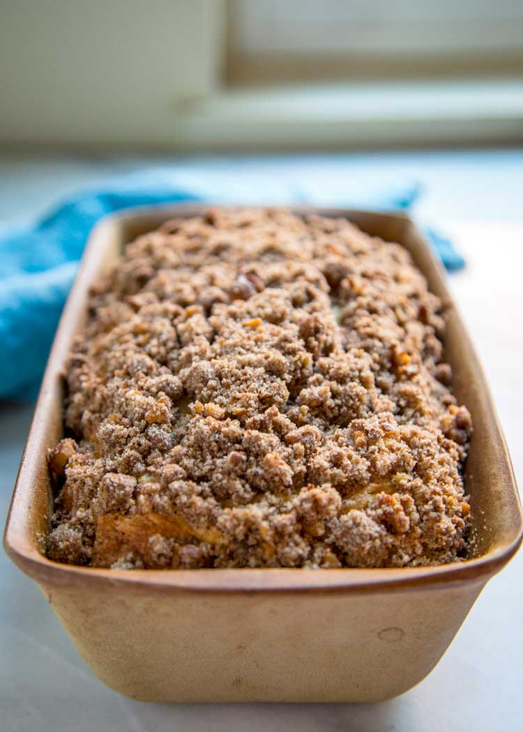 This tender Cranberry Nut Bread is the perfect way to wake up with a cup of coffee or tea. Loaded with cranberries and a crunchy cinnamon streusel topping. keviniscooking.com