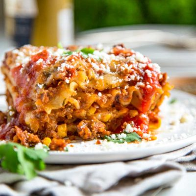 Going the Tex Mex route on this Hearty Mexican Lasagna, I kept with traditional lasagna noodles and went south of the border for spices. Refried beans, corn, two cheese with a beef and pork salsa meat sauce make this a crowd pleaser. keviniscooking.com