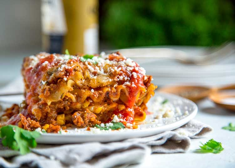 Going the Tex Mex route on this Hearty Mexican Lasagna, I kept with traditional lasagna noodles and went south of the border for spices. Refried beans, corn, two cheese with a beef and pork salsa meat sauce make this a crowd pleaser.