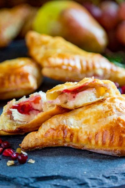 These tender Savory Sweet Baked Brie Bites are super easy to make using puff pastry, dijon mustard, Brie cheese, cranberry sauce, or your favorite jam. keviniscooking.com