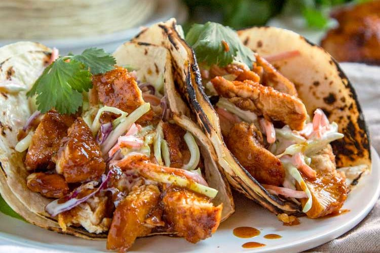 These Honey Lime Chipotle Chicken are a smash hit every time. Grilled or sautéed, the citrus marinade, warm spices, fresh herbs & honey make it a flavor explosion. With a Ranch Apple Slaw on top these are fantastic tacos. keviniscooking.com