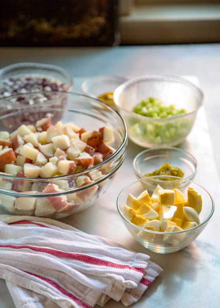 To me the classic potato salad needs to have the right balance of sweet and savory, creamy, tender yet firm potatoes, and not an overload of mayonnaise. Let me show you How to Make the Classic Potato Salad. This is your new go to version.
