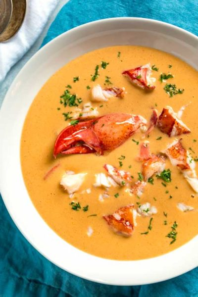 overhead image: lobster bisque in white bowl