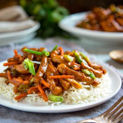This Sweet and Spicy Korean Pork Stir Fry has strips of marinated pork loin that are seared with fresh vegetables and tossed with a sweet and spicy sauce that includes plum jam and the Korean paste gochujang. This is lip smacking good! keviniscooking.com