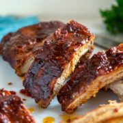 Kansas City Style Ribs are typically characterized by the thick, sticky sauce brushed on in the last 30 minutes of cooking. The dry rub and sauce are on the sweet side using a brown sugar base, but are balanced with chili powder and pepper, producing some truly finger licking good ribs.
