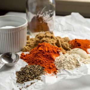 This Kansas City Style Dry Rub is true to the traditional versions with a two to one ratio of brown sugar to paprika as a base then the typical pantry spices like garlic, onion and chili powder as well as cayenne to balance it all out with salt and pepper.