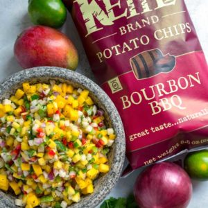 This south of the border, tropical influenced, Mango Pico de Gallo is a hit every time. Sweet and tangy pieces of mango mixed with diced peppers, jicama, red onion and cilantro all marinate in fresh lime juice, cumin and garlic.