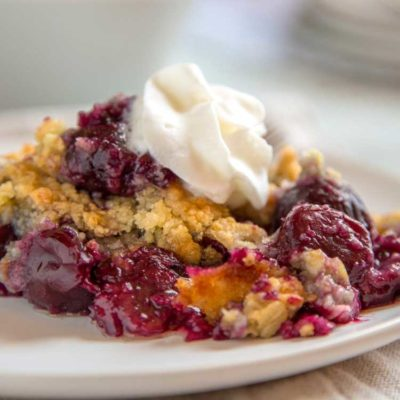 Nothing quite satisfies like a little dessert after a meal, and if it's summer, then it's time for some Old Fashioned Cherry Crisp. Bing cherries covered in a simple flour, sugar, oat and egg crumble that gets melted butter poured on top and baked to a golden brown.