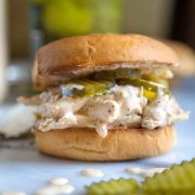 For my Alabama Style Chicken Sandwich you have tender, shredded chicken that's been tossed with Alabama White sauce and topped with dill pickles all on a toasted and buttered hamburger bun.