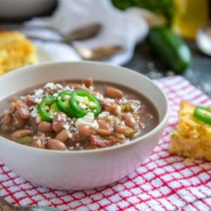 These Cowboy Beans are an old school, Tex Mex style simply using soaked pinto beans and slow cooking them until tender. For the flavor punch you add a sautéed mixture of bacon, onion, garlic, jalapeño and cumin. These are outstanding and so simple.
