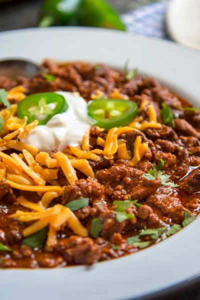 hearty chili recipe in a white bowl - made with beef chuck and ground pork