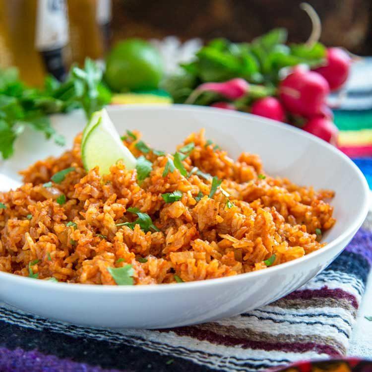 arroz rojo in white bowl