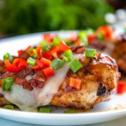 This is my version of the classic Chili's Monterey Chicken recipe where I cook the chicken on the grill instead of stove top and does it ever make a difference! BBQ sauce, bacon, and peppers instead of tomatoes, make this Grilled Monterey Chicken a dinner your whole family will love.