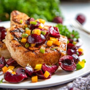 Dry rubbed with a sweet and spicy rub, these grilled pork chops are cooked to tender perfection and topped with a fresh cherry salsa.