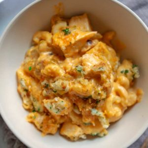 ThisBuffalo Baked Mac and Cheese is super creamy with 3 cheeses, lots of chopped Buffalo sauced chicken and a fantastic bleu cheese breadcrumb topping baked to a golden brown. This feeds a crowd, or halve it for a mid-week dinner, too.