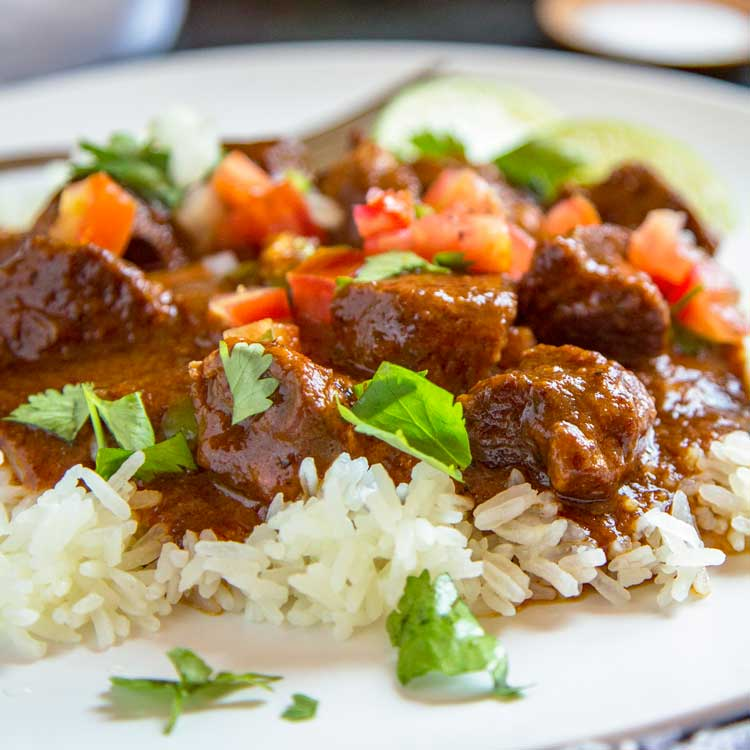 A plate of Carne Adovada with rice