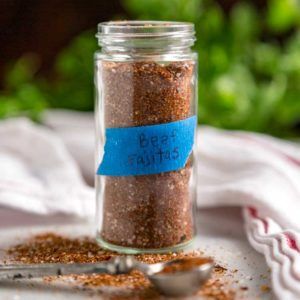 close up: labeled glass spice jar of steak fajita seasoning